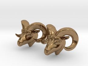 Ram head earrings in Natural Brass