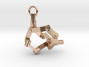 Mechanical earring (left) in 14k Rose Gold Plated Brass