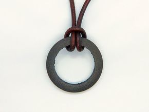 Ring shaped pendant with a raw band inside in Matte Black Steel