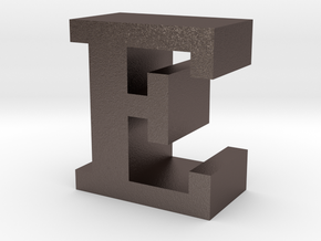 """E"" inch size NES style pixel art font block in Polished Bronzed-Silver Steel"