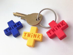 """Think Positive"" Keychain in Red Processed Versatile Plastic"