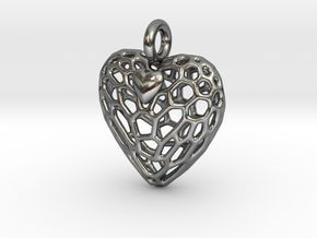 Caged Heart Escaping in Polished Silver