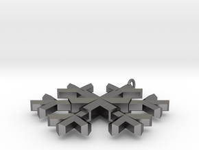 A wee snowflake pendant in Polished Nickel Steel