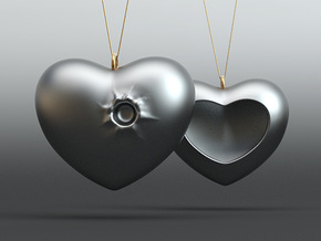 Heart with a bullet hole in 14K Gold
