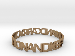 KEEP CALM AND CARRY ON AND ON AND bangle in Natural Brass