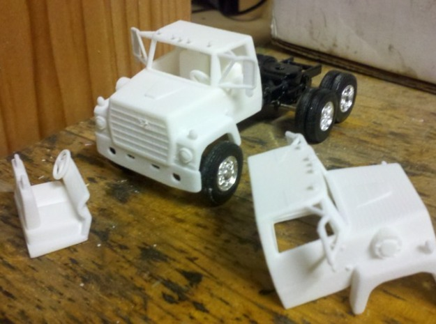 1/64 LN 900 Truck Cab with Interior 3d printed As shipped sitting on Ertl Mack frame