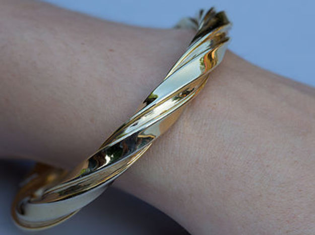 Bracelet With A Twist in Polished Gold Steel