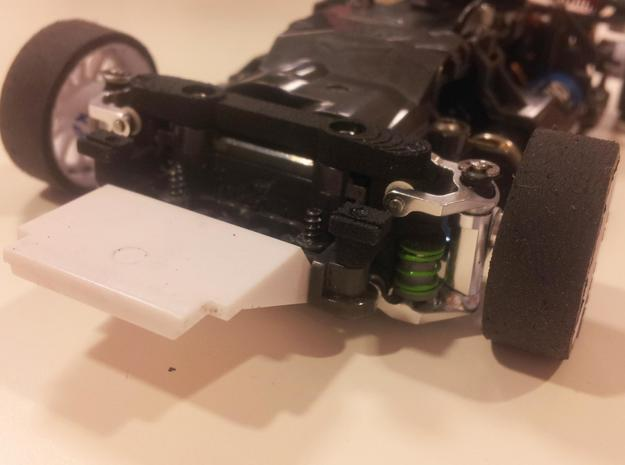 Reactive A-arm mount v3 for Mini-z MR03 3d printed Shown assembled on a MR03 race car. Note that there is no lower tower bar, thus the car can be made much lower. Also, the ride height is easy to set, with only two shims under the main mounting screws.