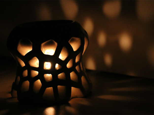 Voro-Scent: Voronoi Tea Candle Evaporator 3d printed Voronoi pattern projected on wall