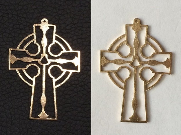 Cross Frame Style with Fish and Shell in Raw Bronze