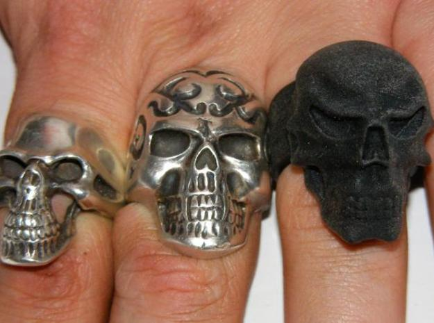 Skull Ring 3d printed Here it is with a couple of silver buddies