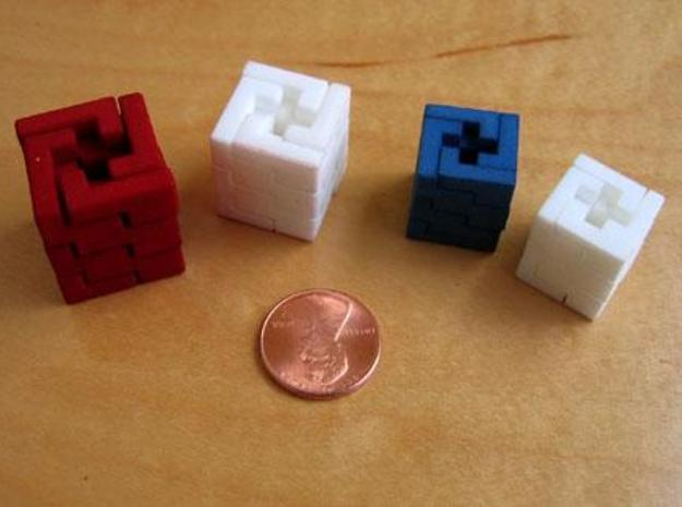Quad Helix 3d printed Four puzzles of various colors and sizes (this version is the smallest)