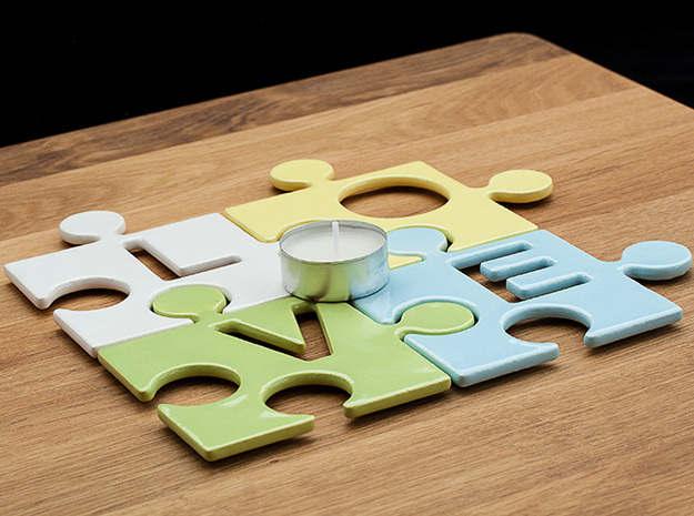 """Puzzle Piece E - """"Love-letters"""" 3d printed 4 puzzle pieces combined to write the word """"love"""". With a tealight for size reference."""