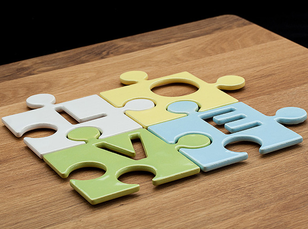 "Puzzle Piece L - ""Love-letters"" 3d printed 4 puzzle pieces combined to write the word ""love""."