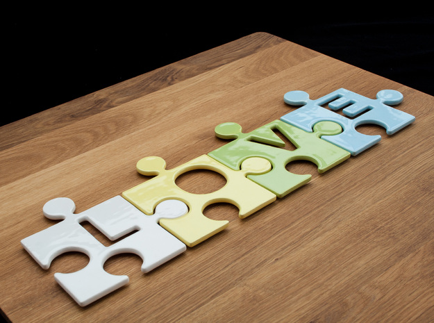 "Puzzle Piece O - ""Love-letters"" 3d printed 4 puzzle pieces combined to write the word ""love""."