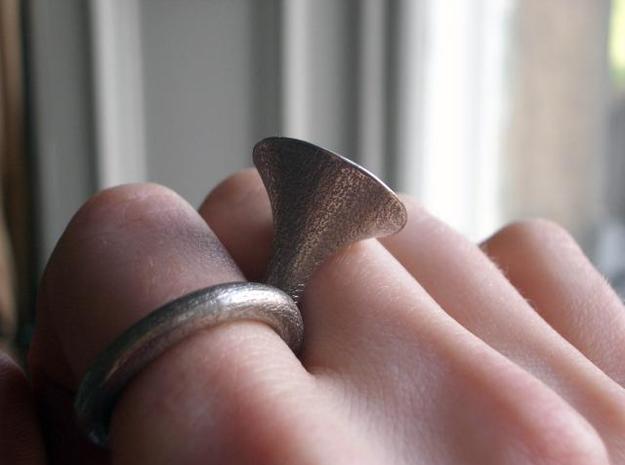 Monotone ring 3d printed on hand