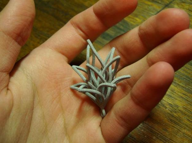 Spiral Flower with loop 3d printed In hand 1