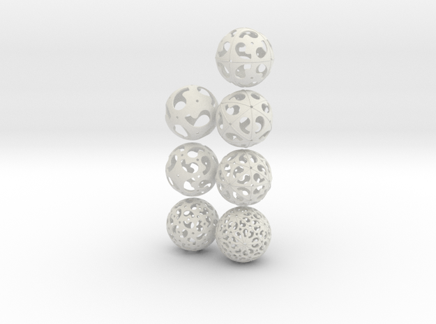 Comma symmetry spheres: 7 infinite families in White Natural Versatile Plastic