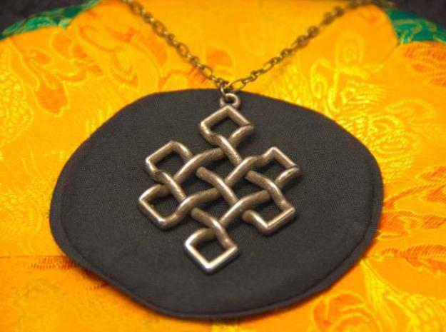 Endless Knot Pendant 3d printed Photo of Stainless Steel pendant on a chain.