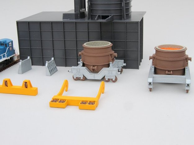 N-scale assessories for 250 ton Teeming Ladle 3d printed Family portrait of the 250 ton ladle series. Walthers Cornerstone Electric Furnace and switcher shown for size reference.