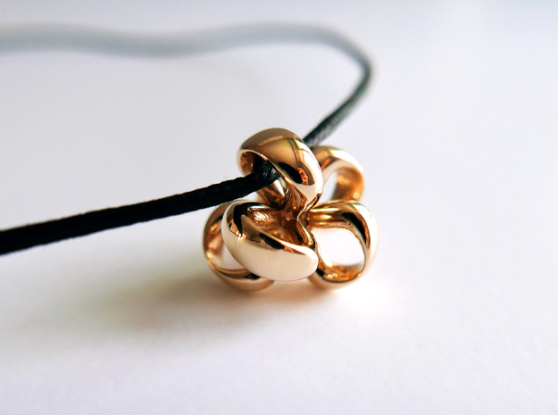 Mutiple Ribbon Pendant in Polished Brass