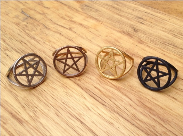 Pentacle ring (customize) 3d printed Left to right: stainless steel, raw brass, matte gold steel, matte black steel.