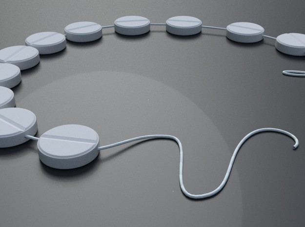 Pill Shaped Beads that Can be strung as Beads in White Natural Versatile Plastic