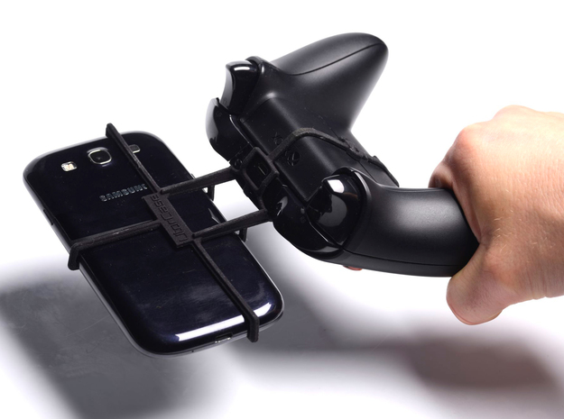 Xbox One controller & Samsung Exhilarate i577 3d printed In hand - A Samsung Galaxy S3 and a black Xbox One controller