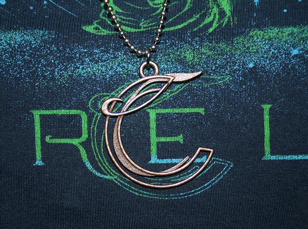 """Corelia Pendant 3d printed size comparison with """"risen"""" t-shirt logo"""