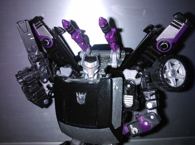 Painted final version on Super Vehicon.  Unfortunately due to a combination of silver paint and camera flash the details are somewhat lost, but all detail shown on the rendered version is present in the printed model =)