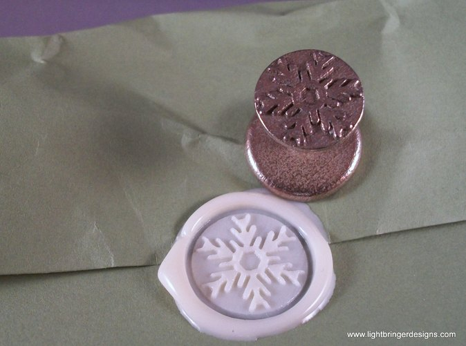 Snowflake wax seal with  impression in Bone White sealing wax