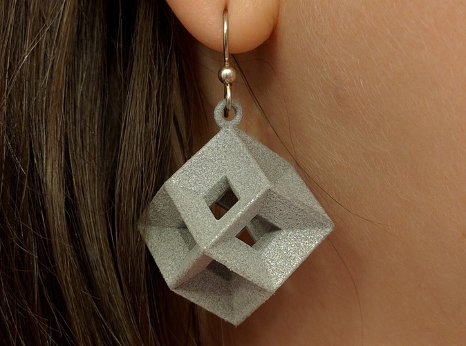 a single earring made in polished metallic plastic. ear hook not included