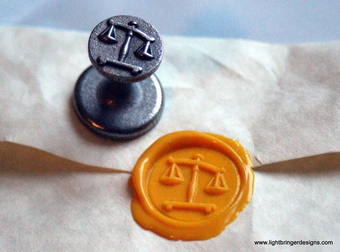 Scales of Justice Wax Seal in Stainless steel with impression in Sunflower Yellow sealing wax
