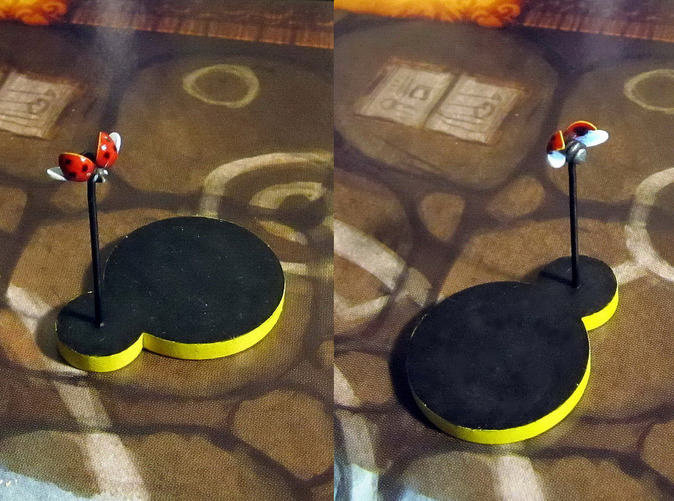 Model hand-painted, after assembly and quick filing. Front and back views (game board with flagstones copyright Plaid Hat Games).