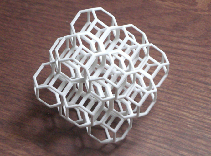 14 packed cubeoctahedra filling space. Photo is of white strong & flexible plastic.