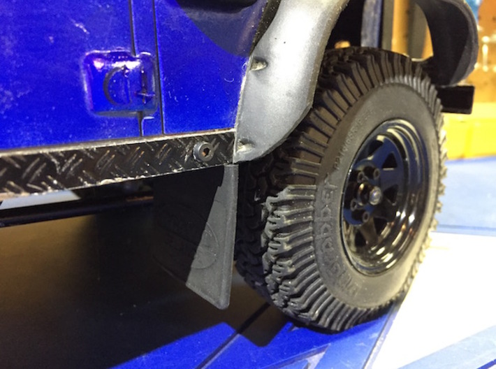 Defender Front Mud Flap Mounts 3d printed Final result with slightly modified mud flap to fit body.