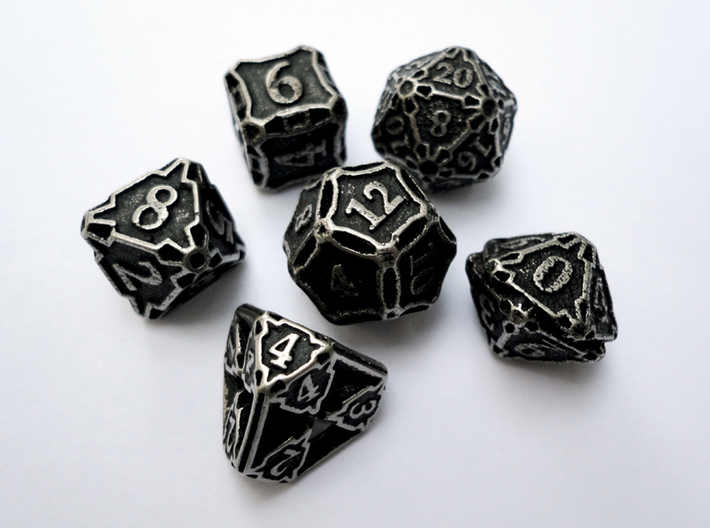 Premier Dice Set 3d printed In stainless steel and inked.