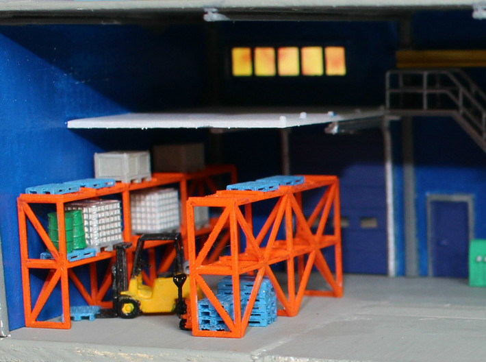 N Scale Warehouse Rack 3d printed Painted warehouse rack in a building with various of my logistics related items. Forklift by Wuttermelon