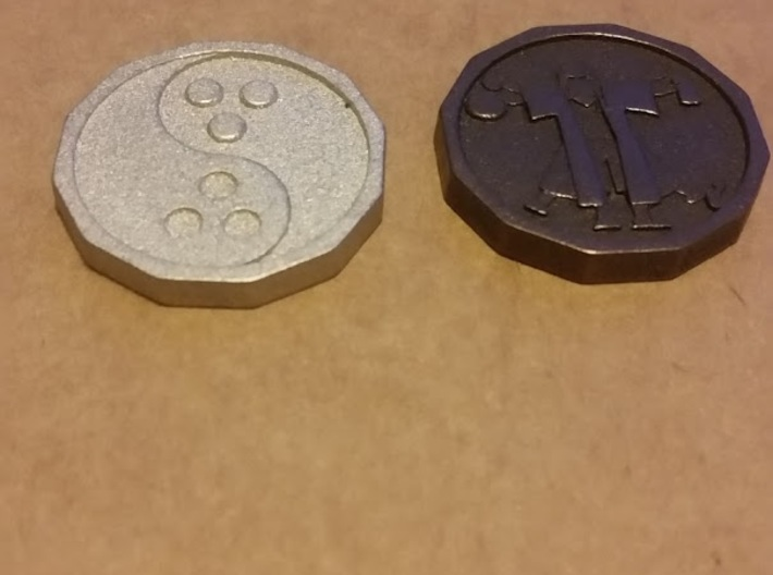 Dudeist Coin 3d printed Printed in Polished Nickle Steel and Matte Bronze Steel. Quarter is for size reference only, sadly these aren't real currency.