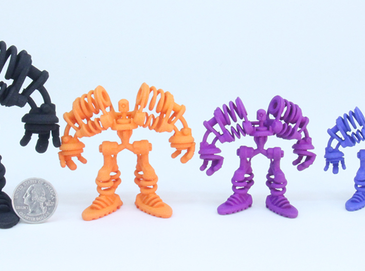 """Springbot V2-7 /Series#1 (100% 6.9cm/2.72"""") 3d printed group of SLS items with quarter for scale"""
