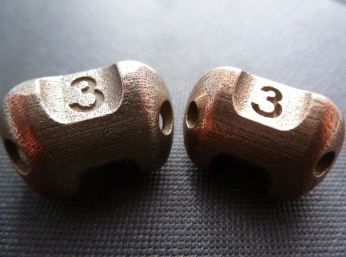 Three sided 'pepperpot' dice  3d printed Version 2 (current) on left. V1 didn't roll well, was harder to clean, and was smaller yet more expensive