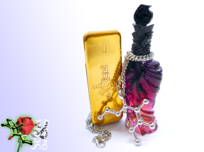 Pomarose 3d printed Pomarose pendant on a rhodinated Oro Vivo SK20259 curb-chain necklace in front of miniatures of '1 Million for men' (Paco Rabanne, 2008) and 'John Galliano for women' (John Galliano, 2008).