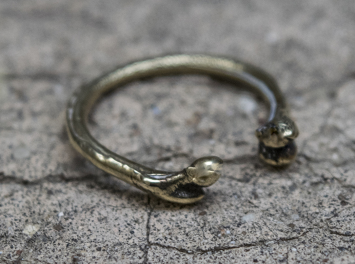 Bone adjustable Ring (Woman size) 3d printed Please note that the ring in the picture is polished