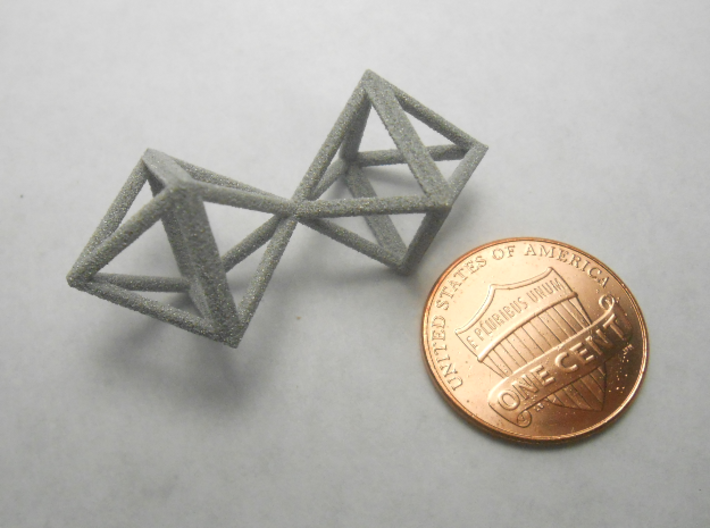 Faceted Twin Octahedron Frame Pendant Small 3d printed Coin scale.