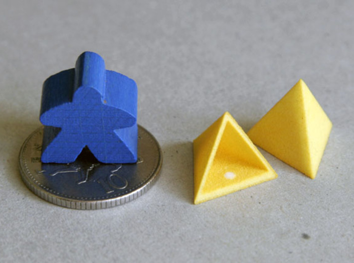 Tetrahedron Capstones (x5) 3d printed Showing scale with ten pence coin and meeple.  Also shows the sprue cut-off point inside the capstone.