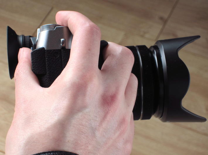 Grip for X-T10 3d printed The overall shape of the grip was designed with ergonomics in mind.