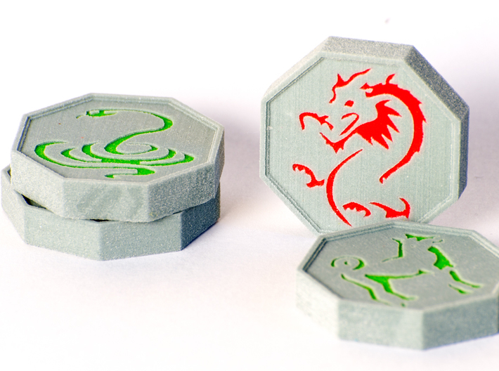 Jackie Chan Talismans (Tiger in Halves) 3d printed A photograph of four of the talismans. Pictures are the Snake, dragon and dog. The texture is much subtler on the actual models.