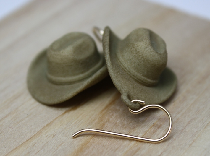 Cowboy Hat Earrings 3d printed Shown in Strong & Flexible Plastic, Dyed Beige (Color Not available at Shapeways, please contact the designer).