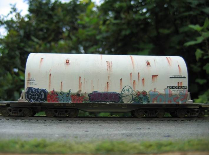 HO 1/87 NASA space shuttle SRB flatcar cover 3d printed No longer used, this SRB railcar cover has become a 'taggers' canvas, and will make an unusual vehicle in my train.