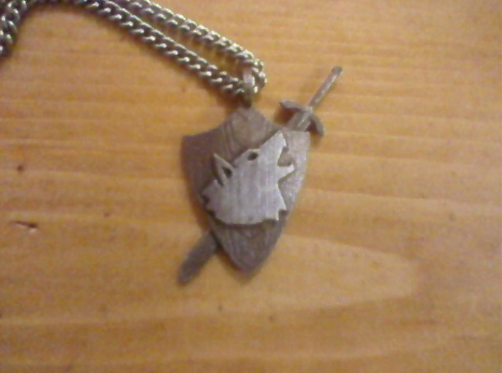 Shield Pendant 3d printed Stainless steel. The wolf head and the finer details on the sword were polished using a tiny buffer.